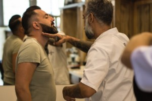 Barber gives client beard explanation at The Barbers Barbershop, hair grooming place for men only. Belgrade, Republic of Serbia.