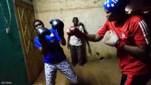 Sahar Mohamed Al Dooma (R), 26, challenges Saraa Mutawkil, 18, during boxing practice at Al Rabie club in Omdurman May 10, 2016. REUTERS/Mohamed Nureldin Abdallah