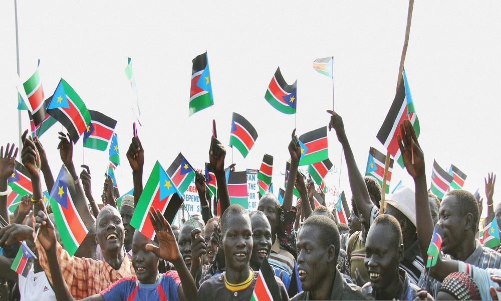 Citizens celebrate the independence of the Republic of South Sudan at the venue of a ceremony to declare the country's official independence from Sudan in Juba on July 9, 2011. [Photo via Getty Images]