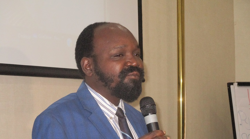 South Sudan Minister of Humanitarian Affairs and Disaster Management, Peter Mayen Majongdit, speaking during a workshop in Juba on Wednesday, December 13, 2020 [Photo by Sudans Post]