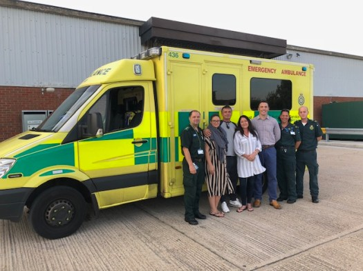 The ambulance crew with family