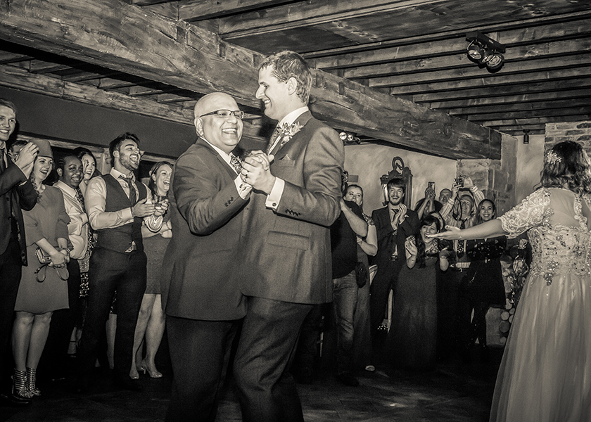 groom and father bride dancing