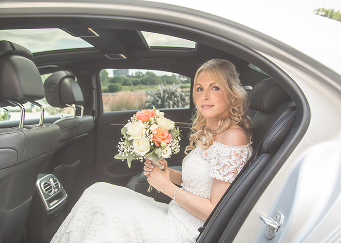 bride arriving in wedding car
