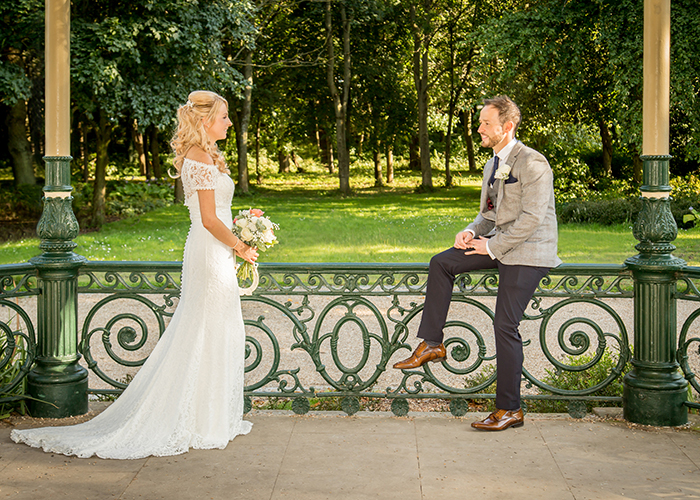 bride and groom in bandstand