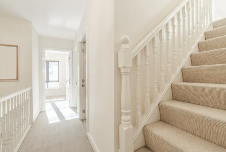 Bright small hallway with stairs in a house