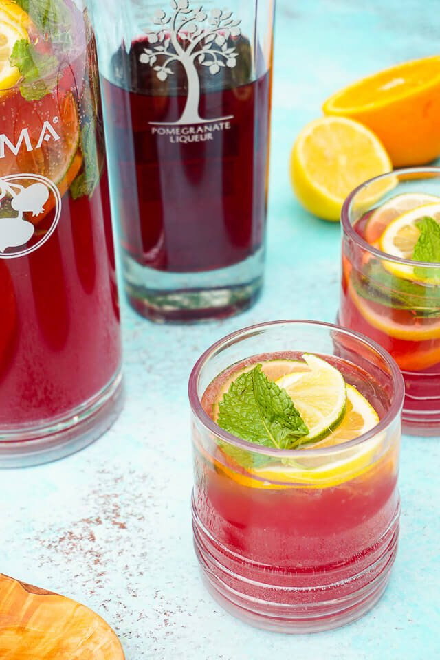 summer with this Pomegranate Citrus Rum Punch! Sweet PAMA Pomegranate ...