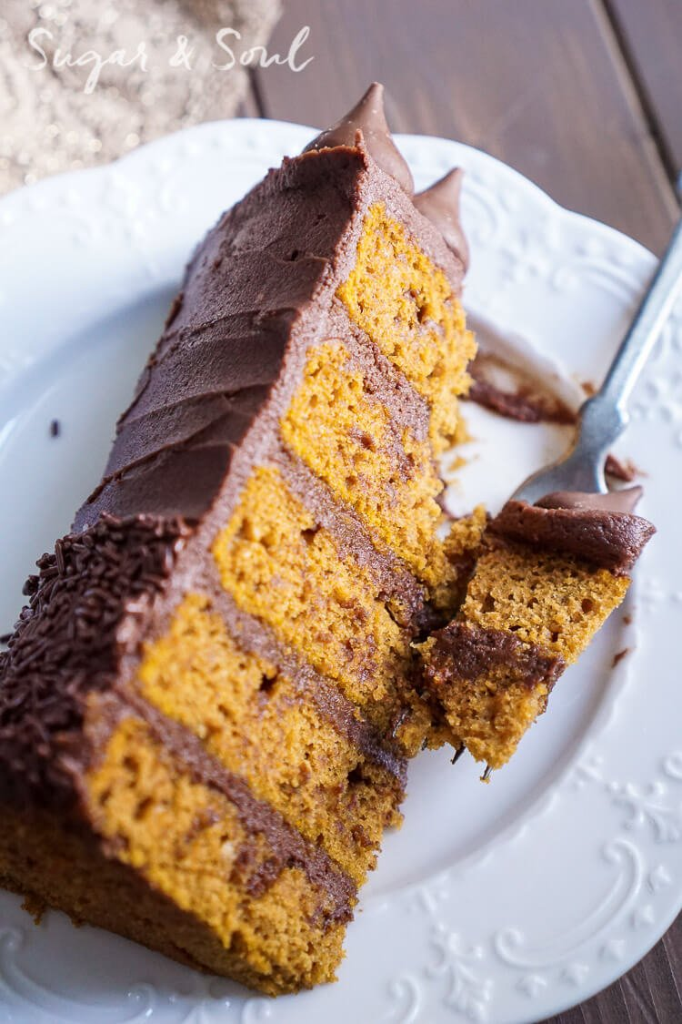 This ChocolatePumpkin Cake is the ultimate pumpkin and chocolate combo for fall! Five layers of sweet and fluffy pumpkin cake wrapped in a whipped chocolate buttercream frosting!