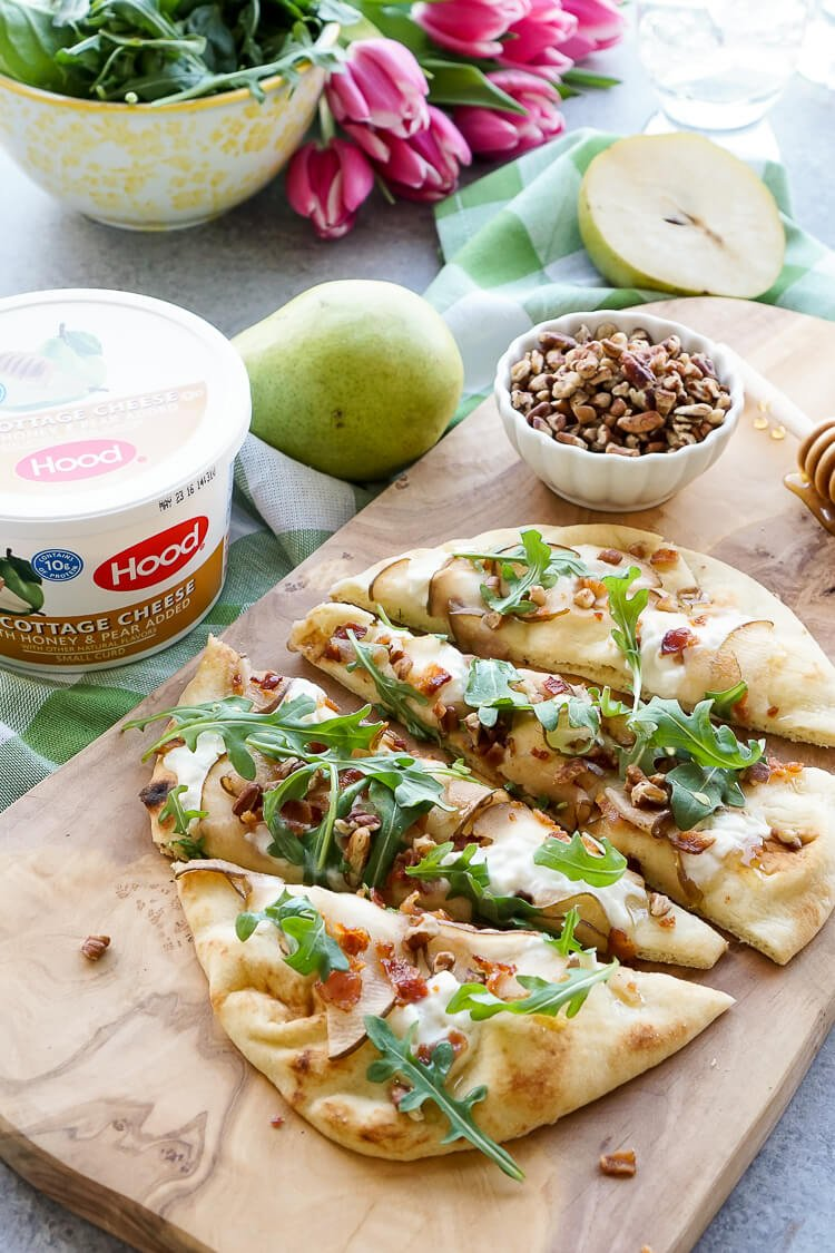 This Honey Pear Pecan Bacon Flatbread is the perfect light lunch, snack, or appetizer and just the slightest bit sweet!