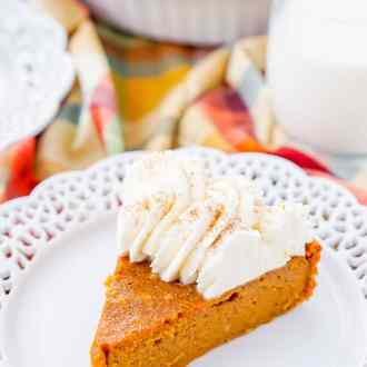 This Impossible Pumpkin Pie Recipe is actually the easiest pumpkin pie you'll ever make! As it bakes, it forms a light crust on its own and leaves behind a dense, but creamy pumpkin filling. Top it with whipped cream and it's the perfect fall dessert!
