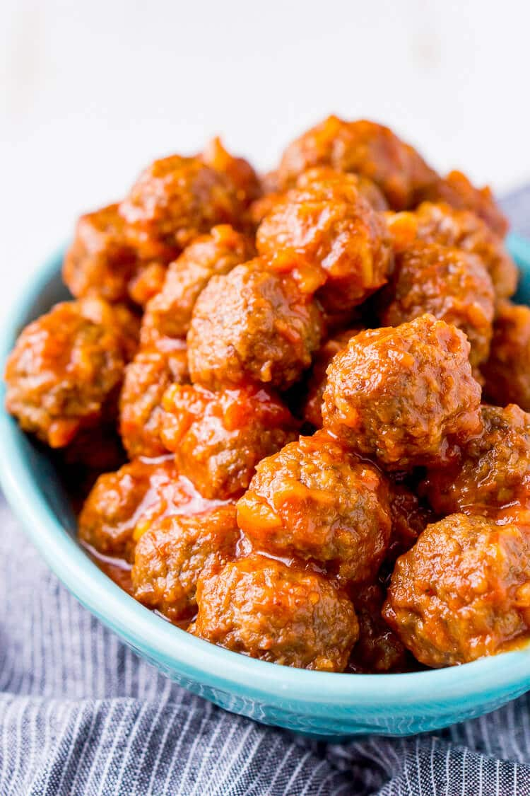 Pineapple Tequila Meatballs will get your game day party started out right! Just dump the four ingredients in the crock pot and let them slow cook for about 2 hours and they're ready to go!