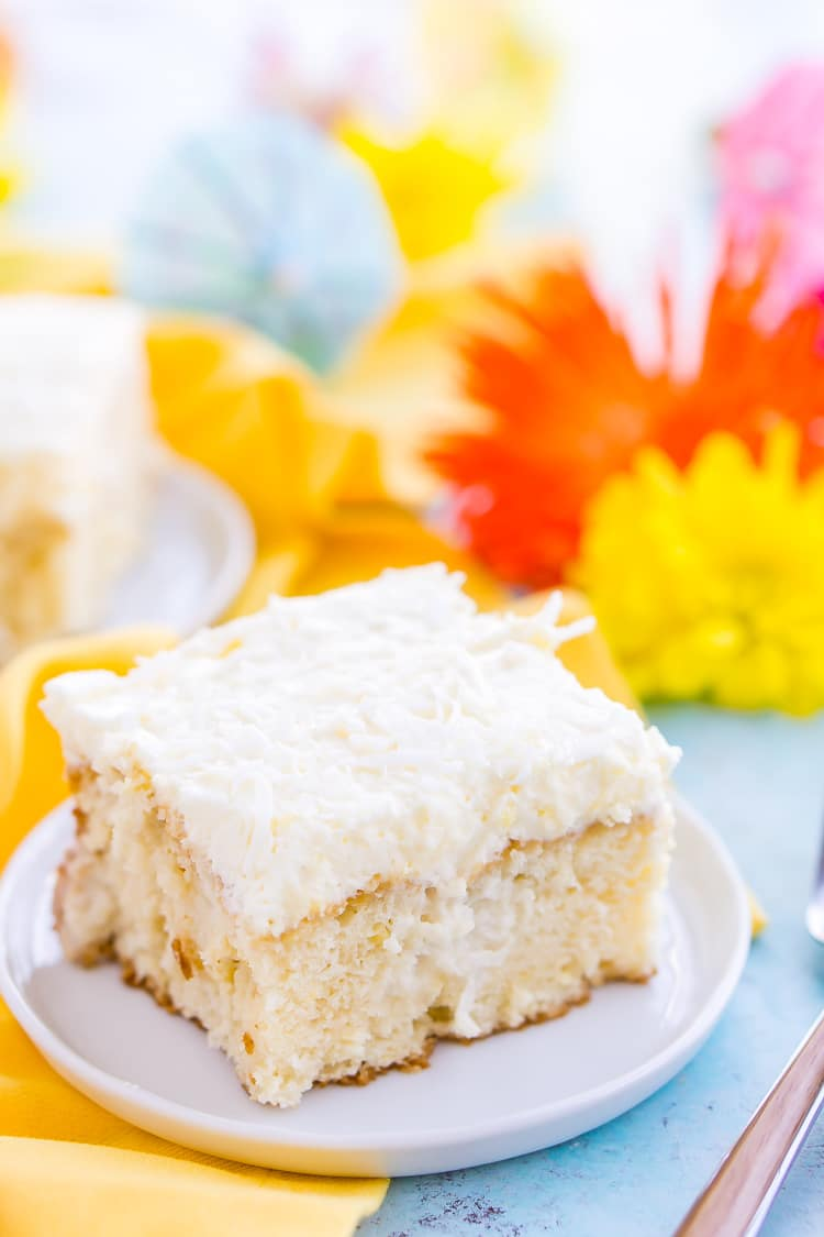 This Coconut Poke Cake is easy to make, loaded with coconut flavor, and the perfect dessert for your spring and summer celebrations.