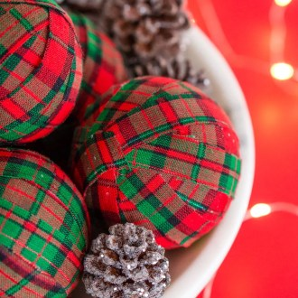 These DIY Holiday Rag Balls are a simple way to add a bit of holiday charm to your home. This craft project is super easy to make with just 4 materials! Makes great ornaments and party favors too!
