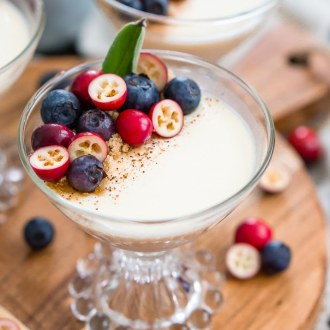 This Maple Panna Cotta is a light and creamy fall dessert that's simple to make and impressive to serve holiday dinner guests!