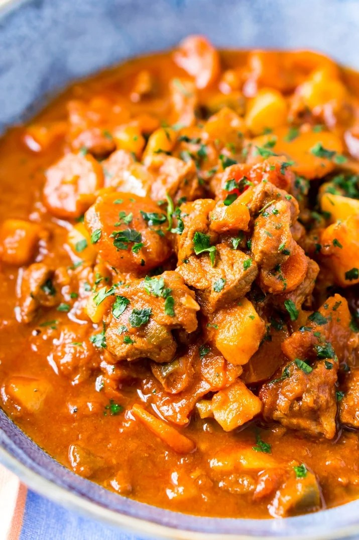 This Hungarian Goulash recipe is a rich and hearty dinner loaded with beef, carrots, potatoes, sweet paprika, and more. An easy stew recipe that reheats well and tastes delicious!