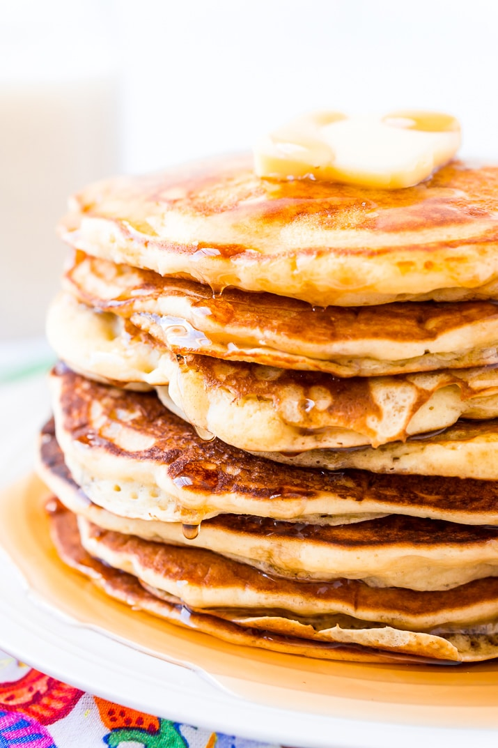 Maple Syrup dripping off Buttermilk Pancakes