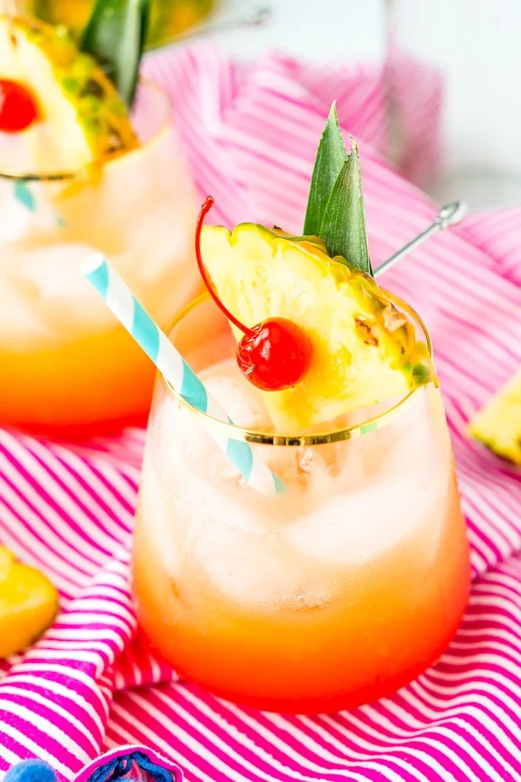 A Mai Tai is a boozy blend of coconut and spiced rum, triple sec, orange and pineapple juices, and a splash of grenadine. Mix up a batch for a taste of the tropics to enjoy with friends and family this summer.