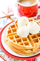 Eggnog Waffles are crisp and golden on the outside and fluffy on the inside, topped with whipped cream and spiced vanilla syrup!