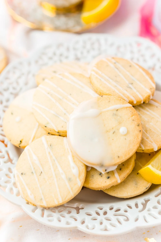 White plate full of Earl Grey Shortbread Cookies with lemon glaze.