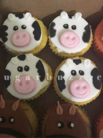 2 web cow cupcakes w