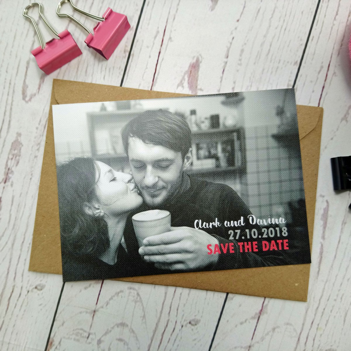 Black and White picture of the bride and groom cuddling. Boy Meets Girl Save The Date. Full picture on white textured card.