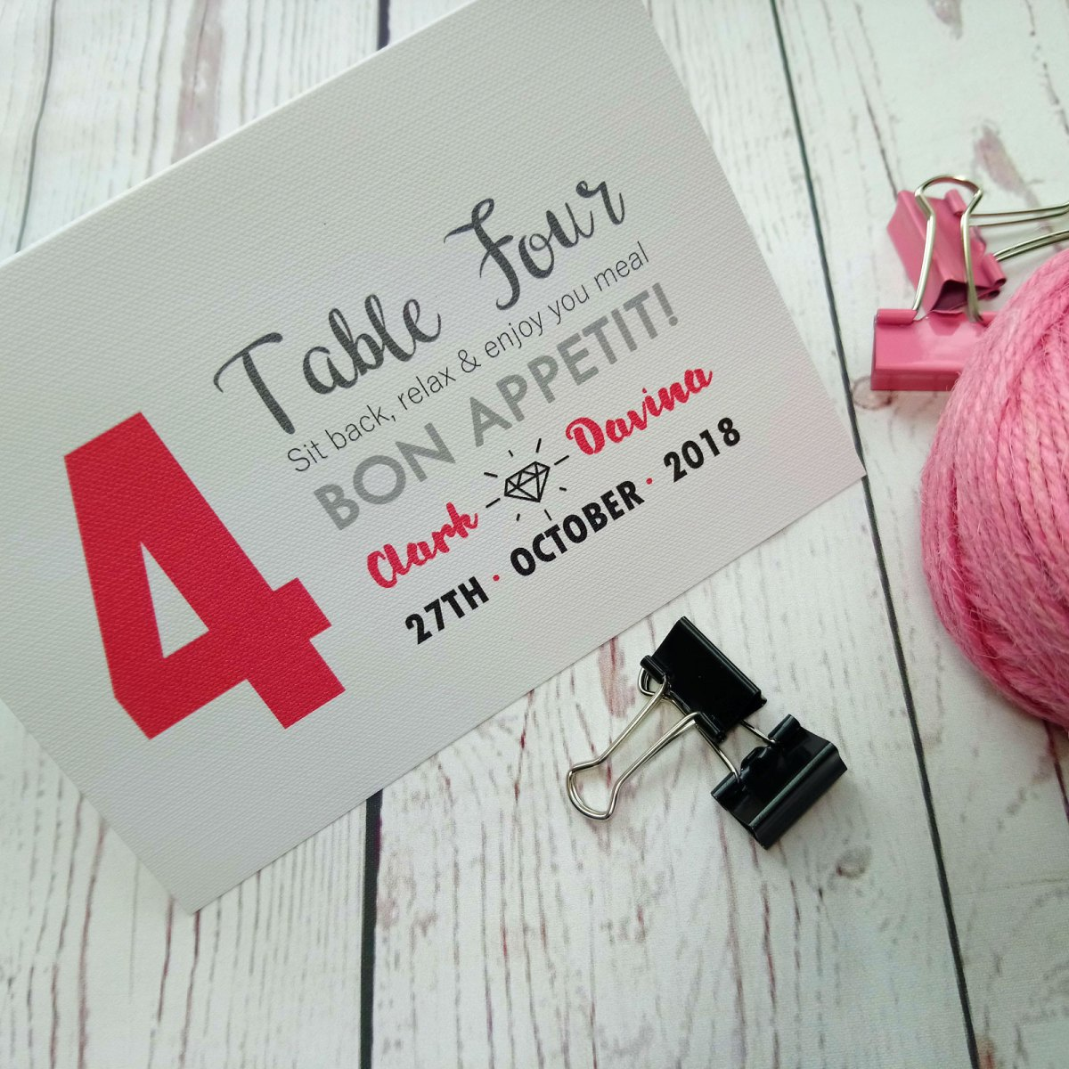 Quirky font in grey, pink and black. Boy Meets Girl Wedding Table Number folded up to stand up on the table.