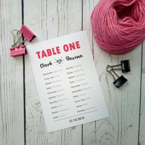 Matching Boy Meets Girl Wedding Table Plan with bride and grooms name and diamon symbol and wedding date at the bottom