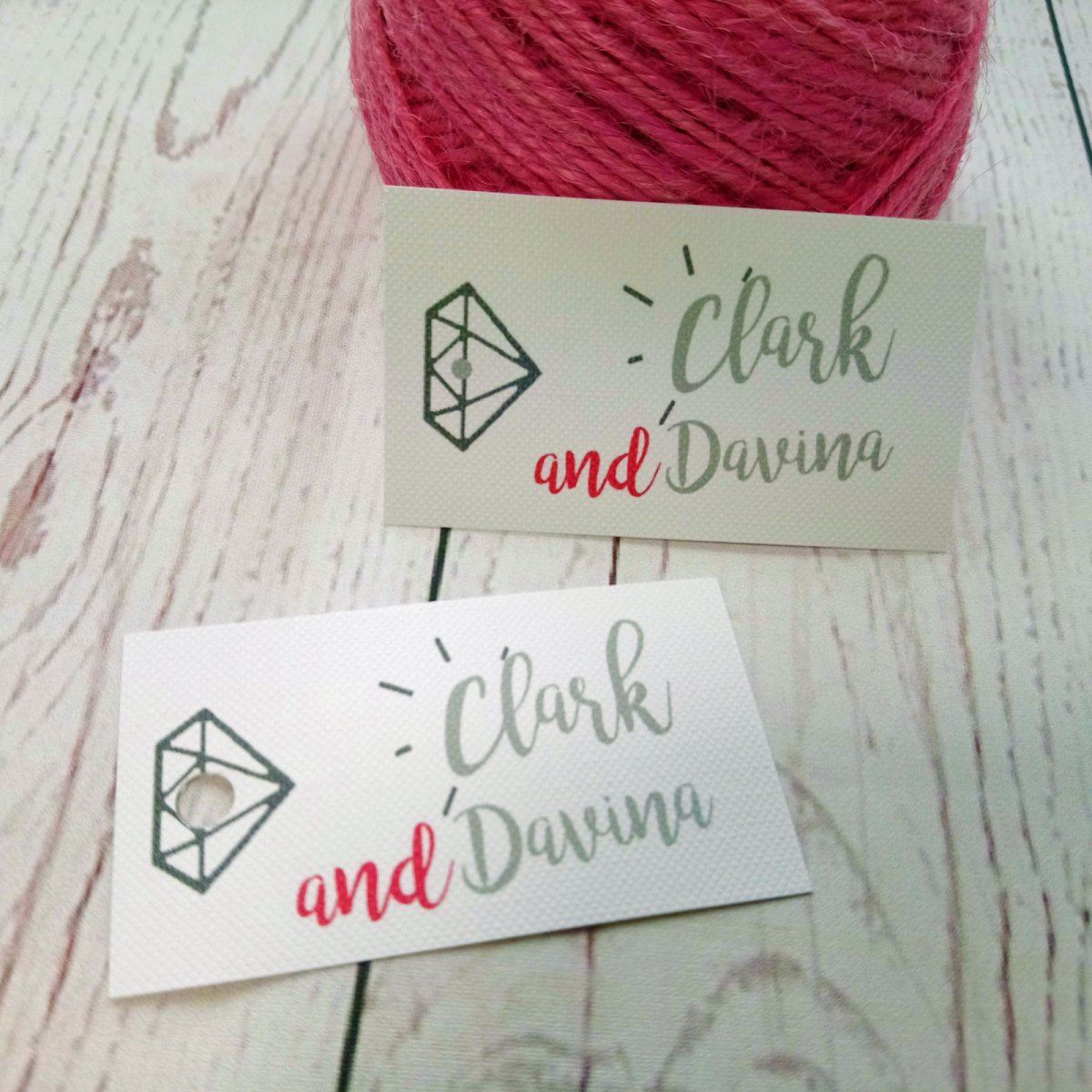 Diamond and bride and grooms name on a hole punched tag. Main colours for the Boy Meets Girl Wedding tag are pink and grey