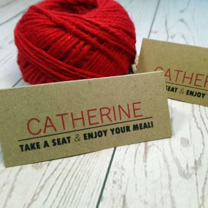 Photo Booth Wedding Place Cards with guest name in red. Take a seat and enjoy your meal under the guest name
