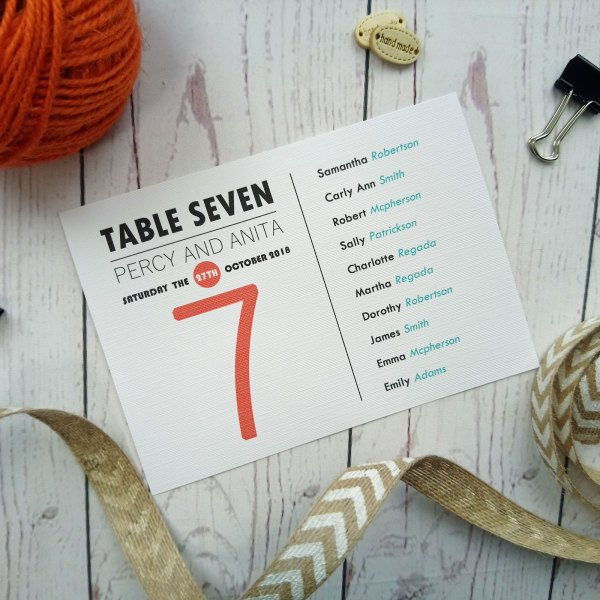 Lovers Tie The Knot Table Number in bright blue and orange