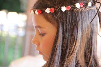 Flower girl with matching rustic red flowers on her hair