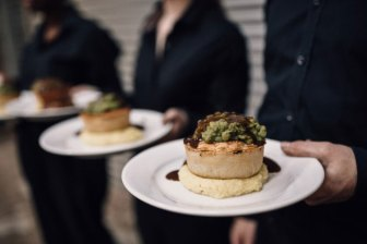 Lined up waiters Pieminister ready to serve wedding pies