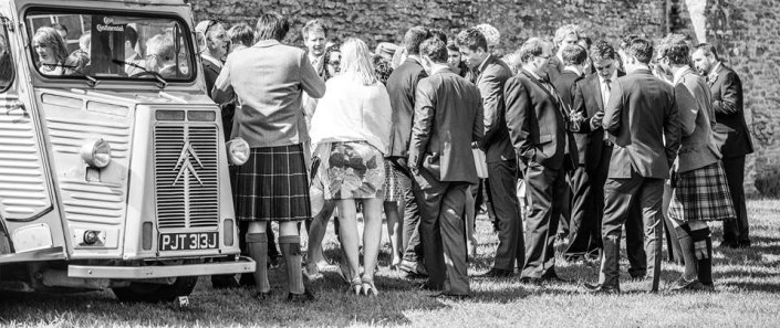 Black and white picture of the cedric with wedding guests