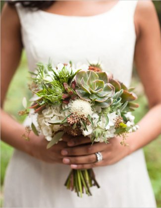 Bride holding succulent wedding flowers