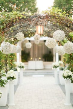 charming white wedding arch with white pompons