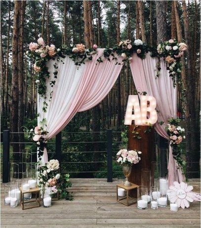 Shabby Chic Wedding Arch with pink and white flowers set outdoors
