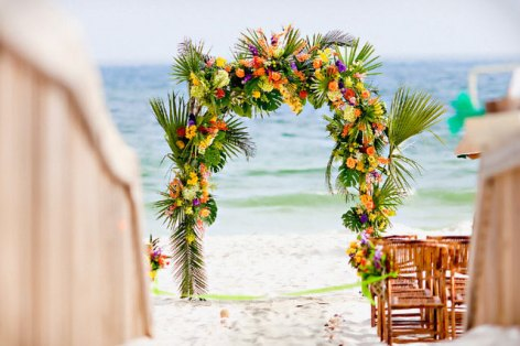 Wedding arch set on the beach with tropical flowers