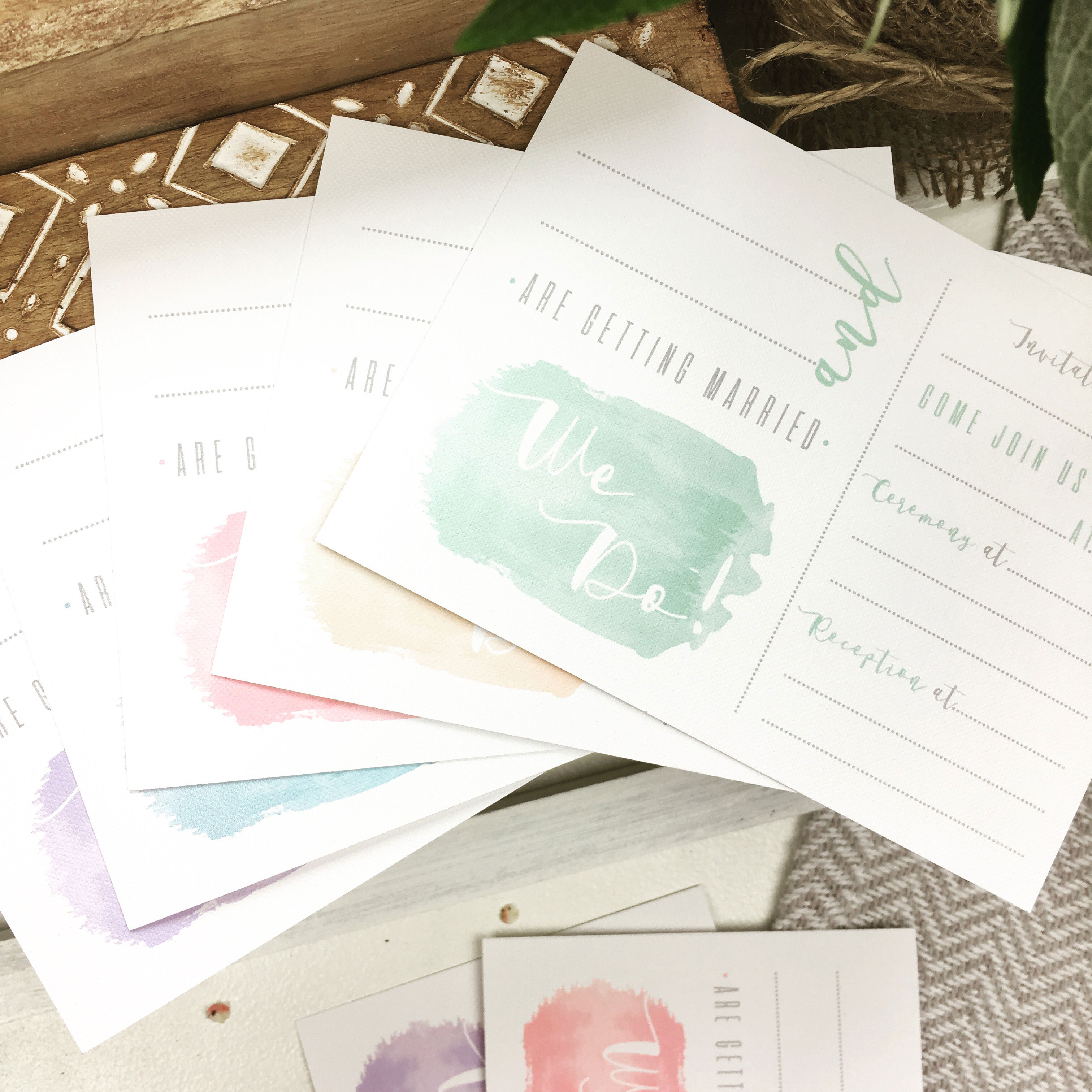 Mix of diy wedding cards in pastel colours