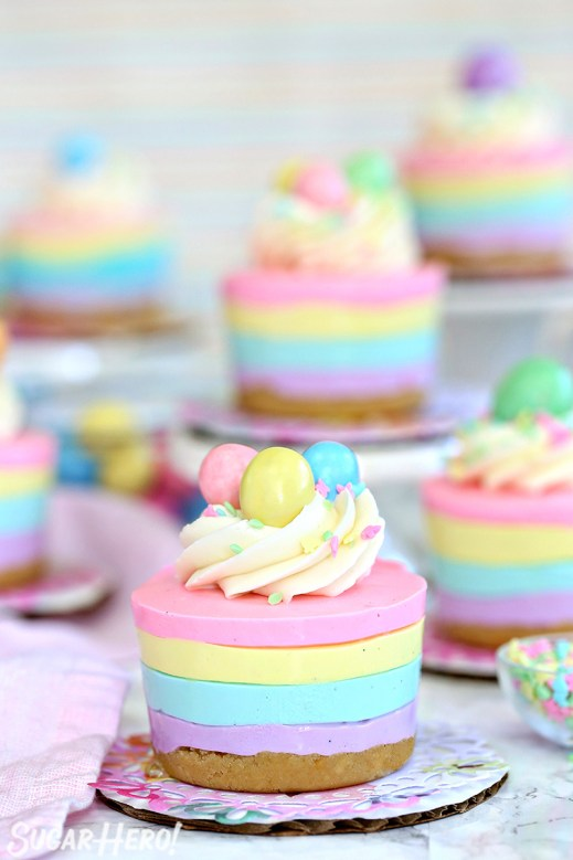 Easter No-Bake Mini Cheesecakes - pastel striped cheesecakes that are super easy, no baking required!   From SugarHero.com
