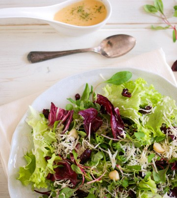Radicchio and wild greens salad with Asiago, macadamia nuts and cranberries