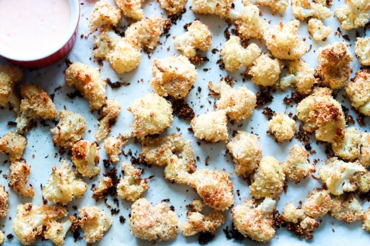 panko and asiago crusted popcorn cauliflower-baked-on baking sheet