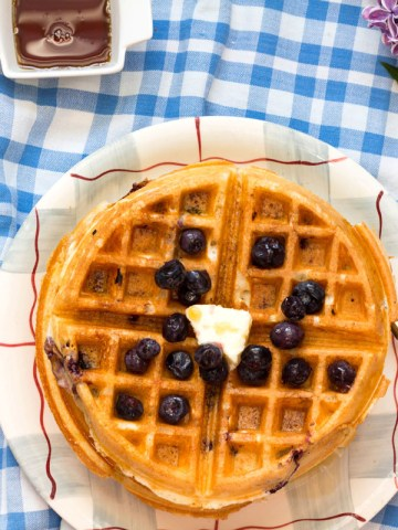 Lemon Blueberry Buttermilk Waffles-feature-stack on a plate with blueberries-from top