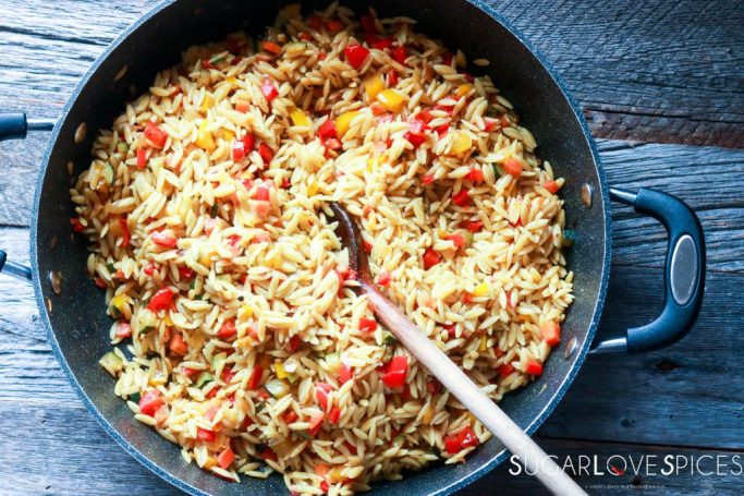 mixing orzo in the pan