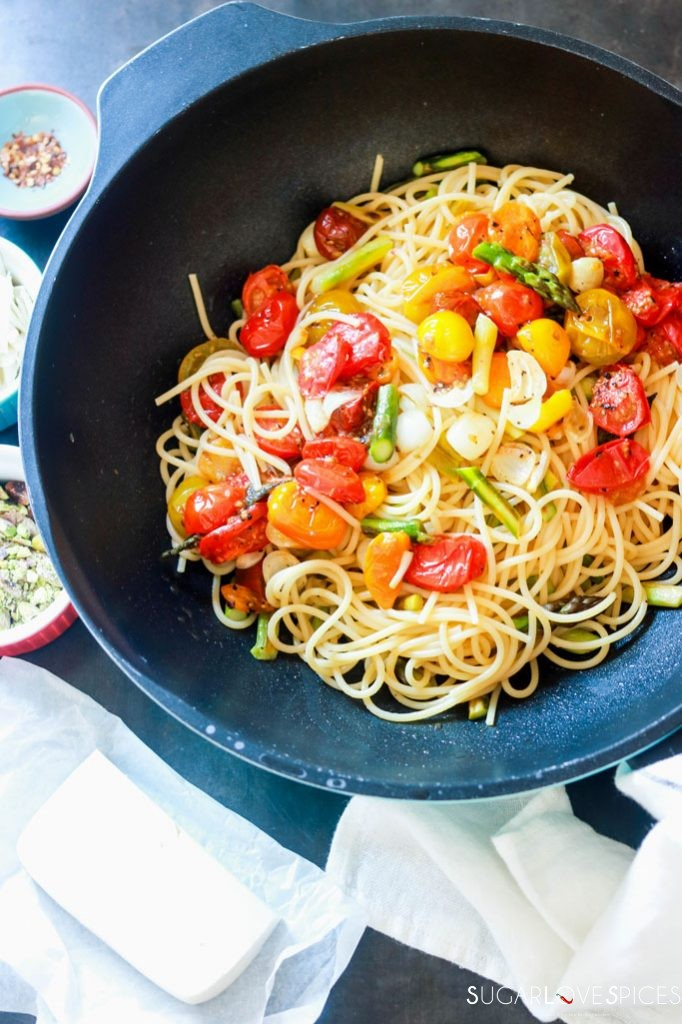 Spaghetti Primavera with Roasted Asparagus and Tomatoes-spaghetti in a pan with veggies