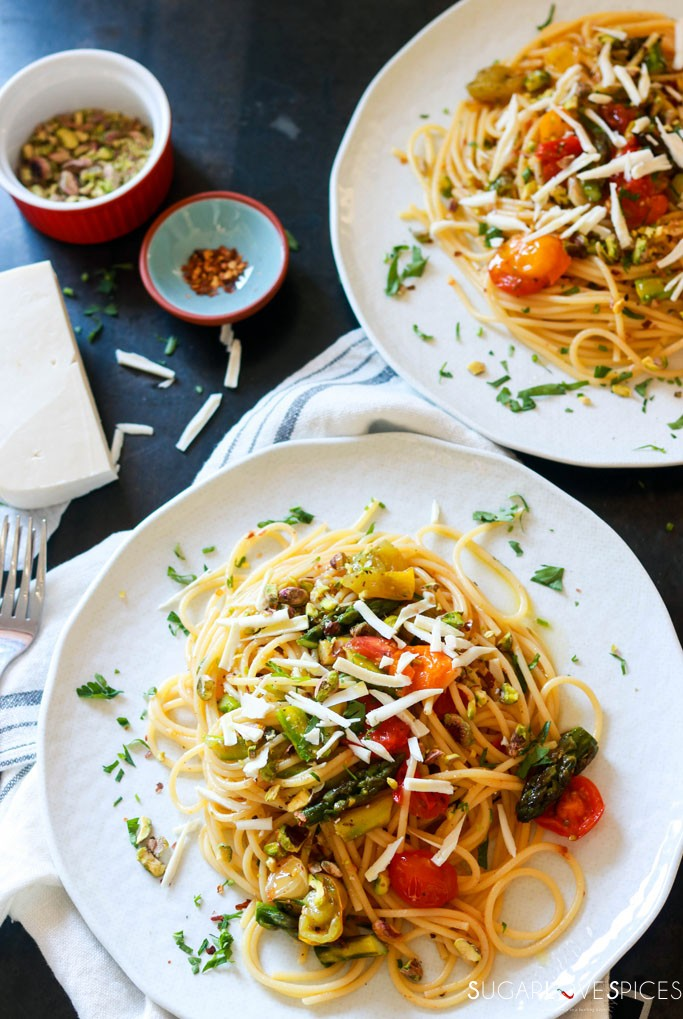 Spaghetti Primavera with Roasted Asparagus and Tomatoes-two plates view from the top