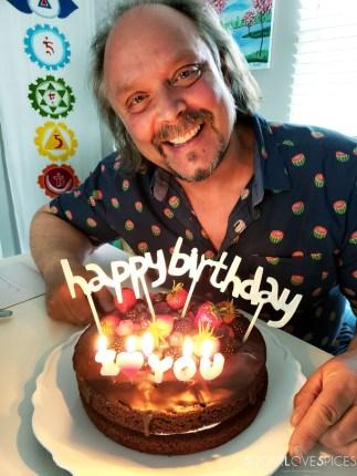 Yogurt Cream Chocolate Ganache Cake with Field Berries-birthday boy with cakes and candles