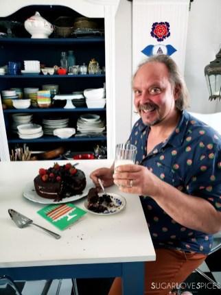 Yogurt Cream Chocolate Ganache Cake with Field Berries-cake and birthday boy with milk