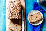 almond butter and jam rye bread-bread on the board and one slice on a plate