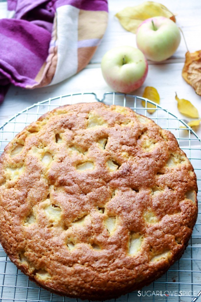 Torta di Mele (Apple Cake with Olive Oil)-whole cake on a board with apples