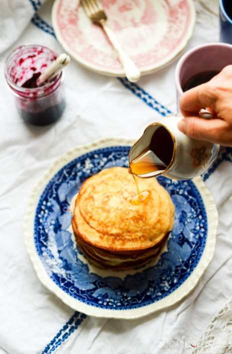 Lemon ricotta pancakes-stack with maple syrup pouring
