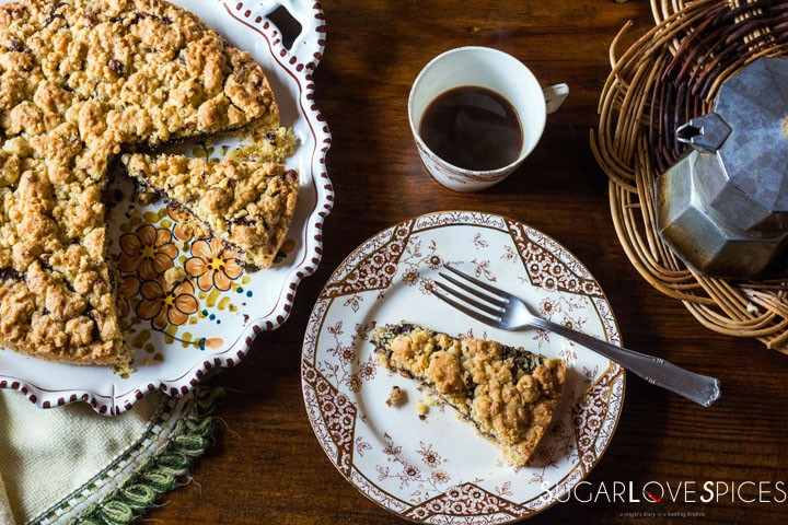 Hazelnut Sbrisolona Cake with Chocolate Spread-a slice on the plate with coffee